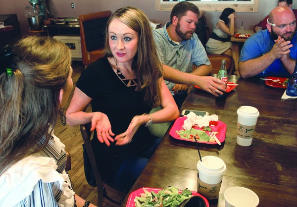Chancy Gerbitz (second from left) with the Central Kansas Community Foundation, and Christy Pickerill (left), who runs two businesses, during the Sept. 18 Newton Young Professionals meeting at Norm's Coffee Bar in Newton.