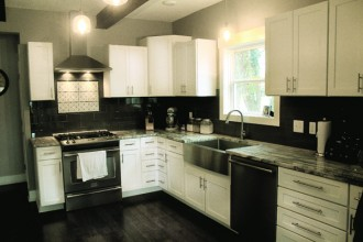 The family's kitchen has a variety of features, like stainless-steel appliances and a large sink. Photo by Wendy Nugent