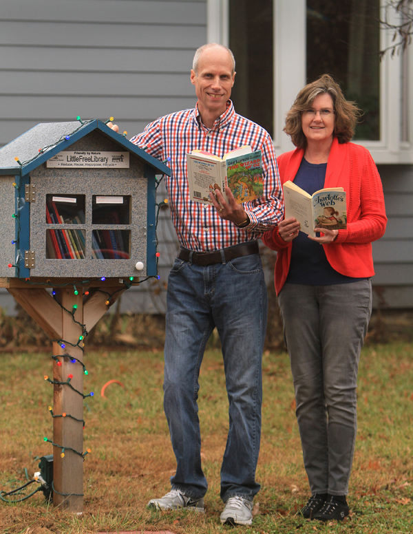 Paul Schrag and Wendy Funk Schrag with their Little Free Library. Photo by Wendy Nugent