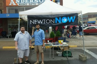 Joey Young and Adam Strunk pose outside of their booth at the Newton Downtown Car Show.