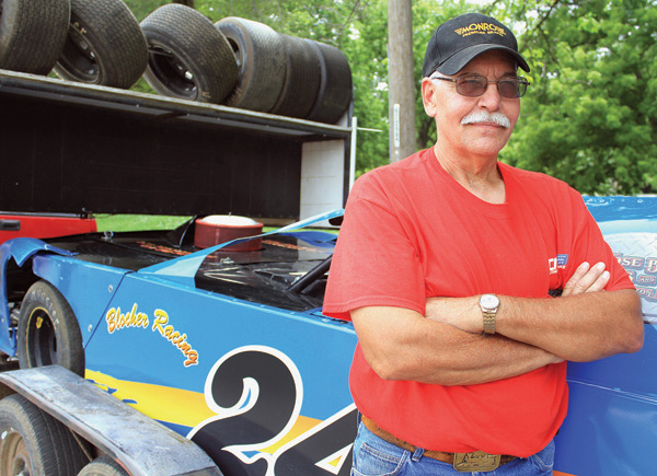 """The competitiveness, the different relationships — yeah, we compete with each other, but we're also willing to help one another,"" Blocher says about dirt racing. ""I like working on (the cars) and the speed."" Wendy Nugent / The Edge"