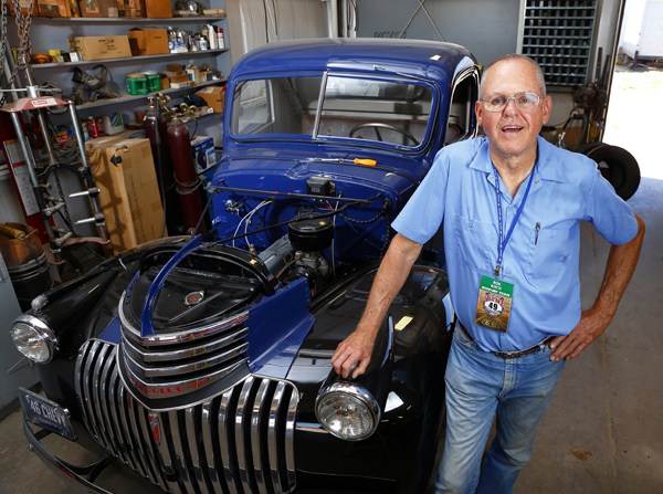Haven's Ron Boese, chief mechanic for the driver and navigator of a 1936 Packard that finished 10th out of 125 classic vehicles in the 2015 Great Race that followed Route 66 from Missouri to California, stands beside a classic 1946 Chevy truck in his shop. Photo by Fred Solis.