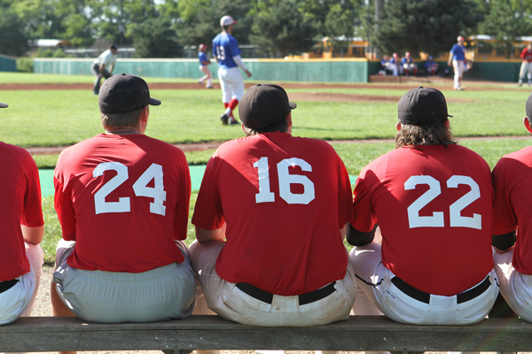 Newton native Trey Tucker (No. 16) looks on from the Newton Rebels bullpen during a game against the Park City Rangers. photos by clint harden/Newton Now