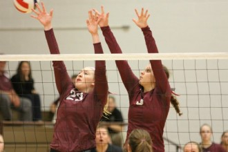 Bethel's Veronica Pitchford (No. 23) and Ashley Dishon go up for a block against Tabor Saturday. Pitchford and Dishon make up half of Bethel's seniors. Photo by Clint Harden