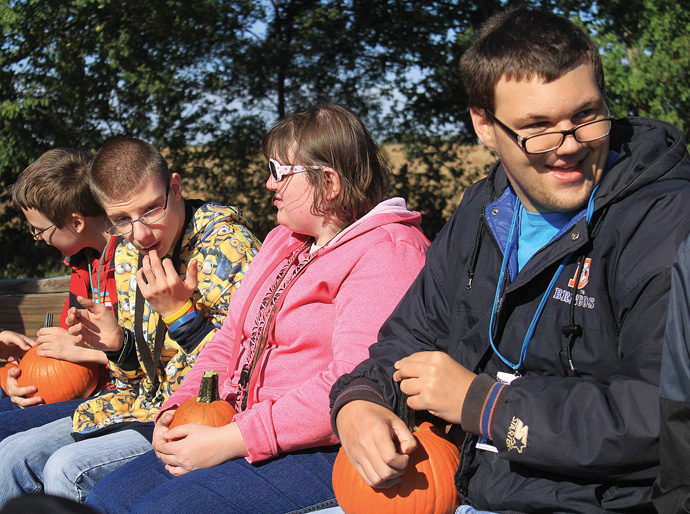 Newton High School students Isaiah Hamill, Brennen Bailey, Summer Hamilton and Jared Williams visit Papa's Pumpkin Patch in rural Newton Friday morning. Wendy Nugent/Newton Now