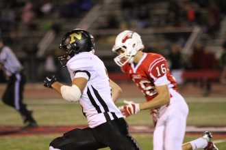 Newton running back Kade Remsberg sprints away from a Maize defender last Friday. He finished the game with four touchdowns. Photo by Clint Harden