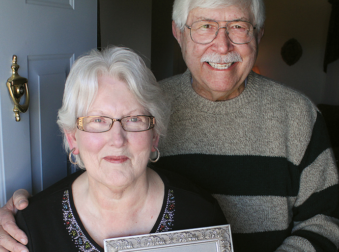 Patricia and Jim Wimmer will celebrate their 51st wedding anniversary on Valentine's Day. Here, Patricia holds their wedding photo. Wendy Nugent/Newton Now