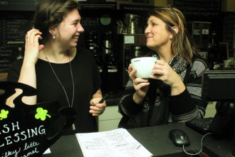 Patty Meier, Mojo's owner, right, talks to manager Meg Leatherman behind the shop's counter.