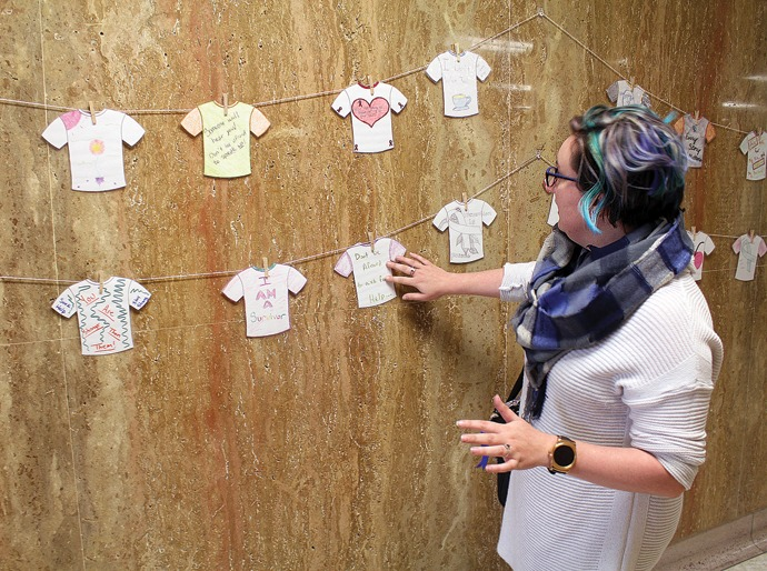 Jessica Taylor, Sexual Assault Project coordinator for the Harvey County Safe House, talks about the Clothesline Project, which will hang in the main hallway on the first floor of the Harvey County Courthouse. Wendy Nugent/Newton Now