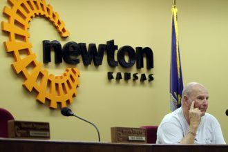 Newton Mayor Glen Davis listens during the special  noon meeting today of the Newton City Commission. Wendy Nugent/Newton Now