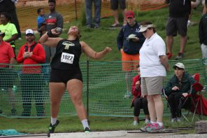 Roberts wins third shot put title at state track