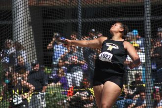 Payton Roberts finishes her high school career with a discus throw of 140-00 at the state track and field meet on Saturday at Cessna Stadium. Roberts took third in the event. Photo by Mike Mendez, Newton Now