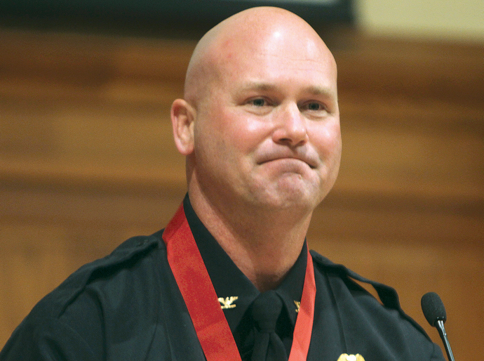 Hesston Chief of Police Doug Schroeder reacts to a standing ovation after he received a Medal of Valor Wednesday night. Wendy Nugent/Newton Now