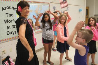 Cathy Edwards shows kids how to do the flamenco dance. Wendy Nugent/Newton Now