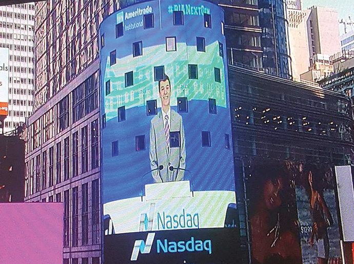 Scott McGehee of Hesston appears on a large billboard on the NASDAQ building in Times Square, New York City. Courtesy photo