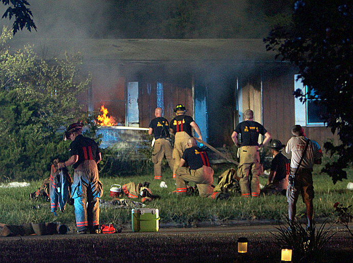Local firefighters work on extinguishing the Thursday night fire. Wendy Nugent/Newton Now