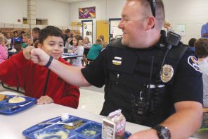 Surprise visit: South Breeze students have lunch with police officers