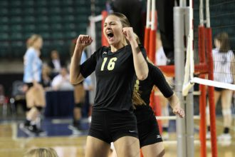 Newton's Kailey Harris celebrates a point at the state tournament in Topeka last season. Harris is one of four seniors who will try to lead the Railers back to the state tournament in 2016. File Photo
