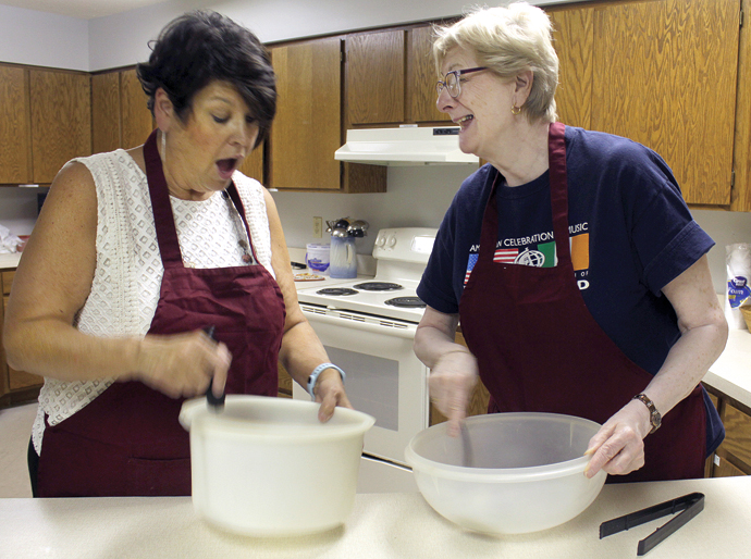 Sound of the Heartland Ensemble members Sue Moore, left, and Pat Thorson enjoy themselves in the kitchen. The group will make New Year's Cookies for Taste of Newton. Wendy Nugent/Newton Now