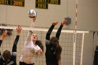 Newton senior Megan Akers gets a kill against Campus during senior night on Oct. 18 at Ravenscroft Gym. The Railers beat Campus and Andover to build momentum heading into sub-state. Mike Mendez/Newton Now
