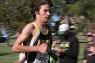 Garrett Mick races through the first mile at the 5A regional cross country race on Oct. 22 in Emporia. Mick finished fifth place, helping the Railers to a second place finish as a team. Mike Mendez/Newton Now