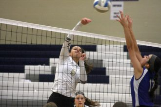 Emily Regier smashes a kill against Kapaun Mt. Carmel during the sub-state championship match on Oct. 22 at Andover High School. The Railers beat the Crusaders to advance to the state tournament as the No. 1 seed. Mike Mendez/Newton Now