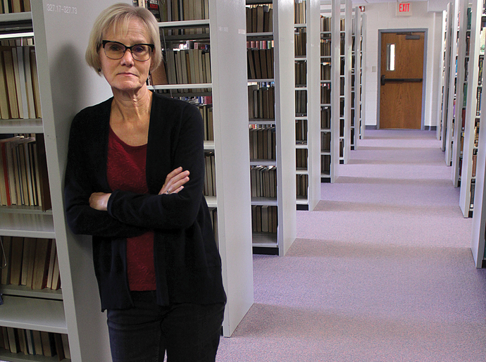 Possible paranormal activity occurred in a hallway, such as this one at Bethel College. Pictured is Gail Stucky, co-director of libraries at Bethel College. Wendy Nugent/Newton Now