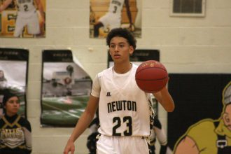 Newton freshman Ty Berry takes the ball up the court in a 67-57 loss to Emporia on Dec. 2. Six 3-pointers in the game helped Berry to a team-high 27 points. Mike Mendez/Newton Now