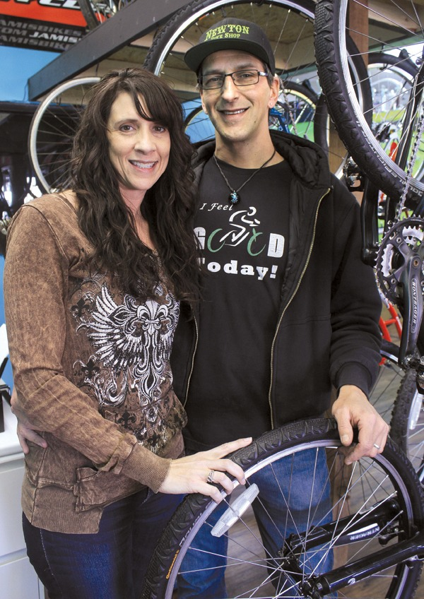 Heather Barringer is the owner of the Newton Bike Shop, while her husband, James Barringer, is the shop manager. ?We work as a team,? Heather says. Photo by Wendy Nugent