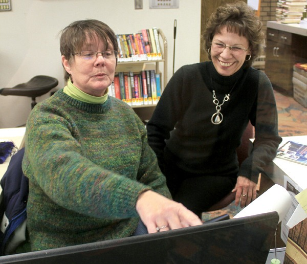 Marianne Eichelberger shares a laugh with NPL employee Susan Bartel. Photo by Wendy Nugent