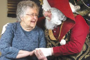 Comfort and joy: Santa visits local memory-care residence