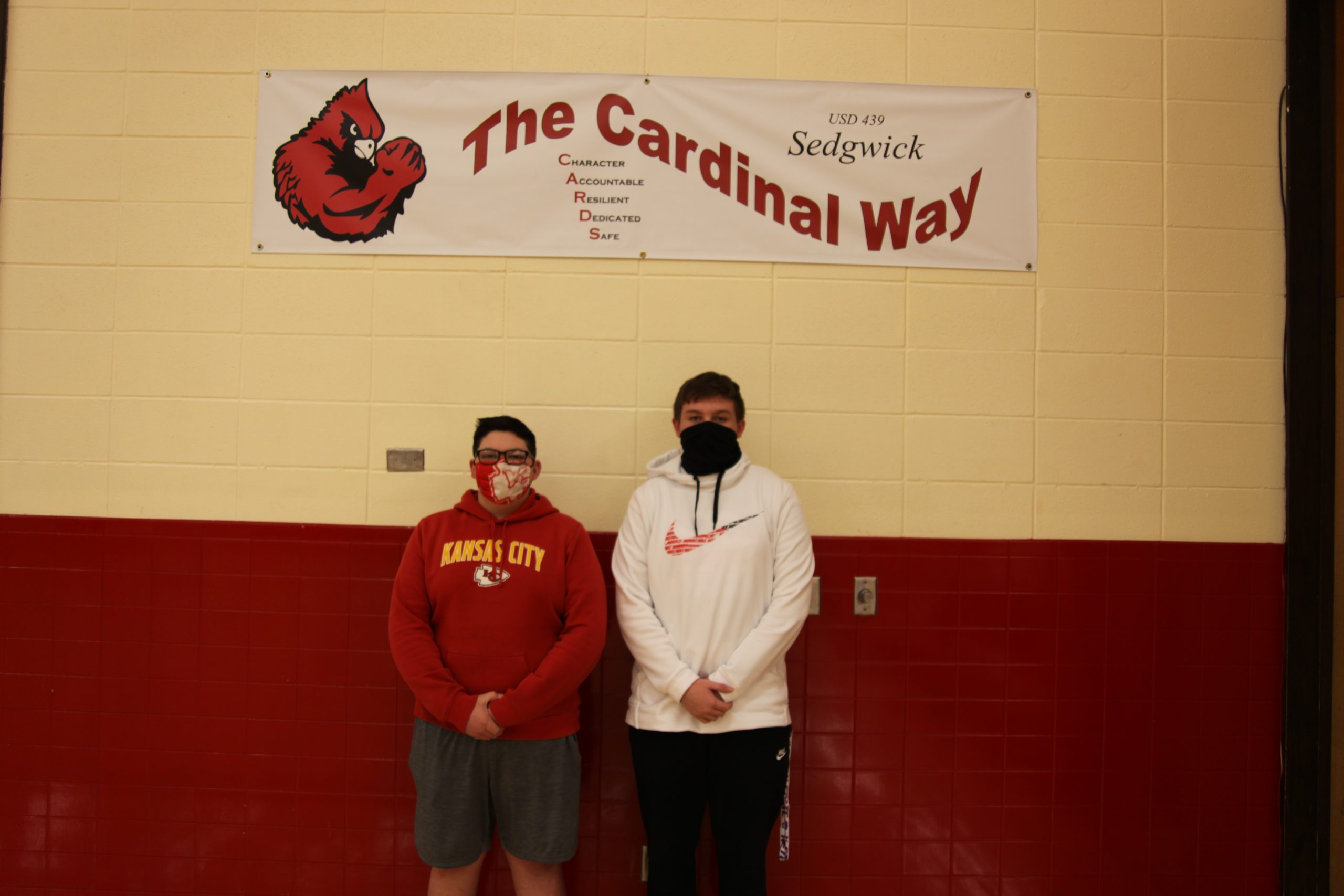Wilkes and Hansen work behind the scenes for Sedgwick basketball